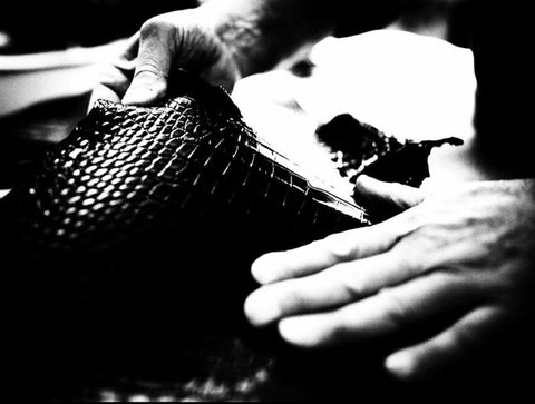 hand working on leatherbag