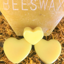 Load image into Gallery viewer, Lotion Bars for Hands & Feet - close up of heart shaped bars and a chunk of beeswax in background