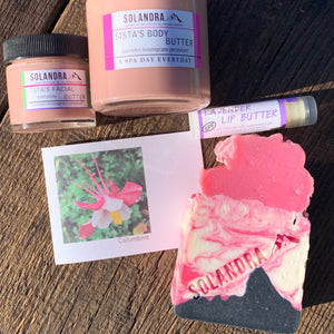 Red columbine flower notecard with Rose-Charcoal Soap, Sista's Facial Butter and Sista's Body Butter