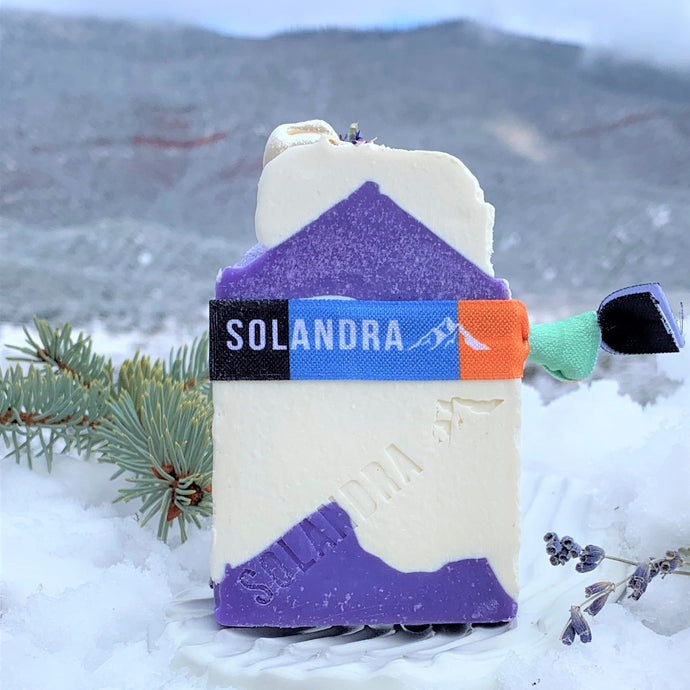 Calm Mountain Soap.  Design is purple mountains, white sky with purple peaked top with snow white soap.
