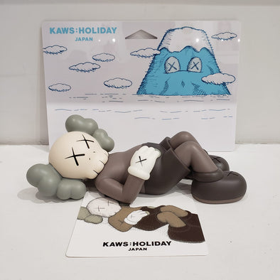 "KAWS:HOLIDAY JAPAN 9.5"" Vinyl Figures (Brown)"