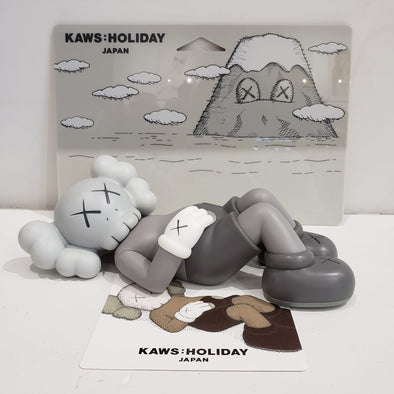 "KAWS:HOLIDAY JAPAN 9.5"" Vinyl Figures (Grey)"
