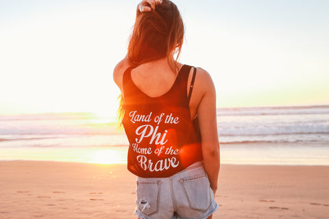 http://shop.thesociallife.com/collections/alpha-phi/products/land-of-the-phi-boxy-tank