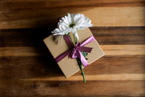 Gift wrapped box with a daisy on top