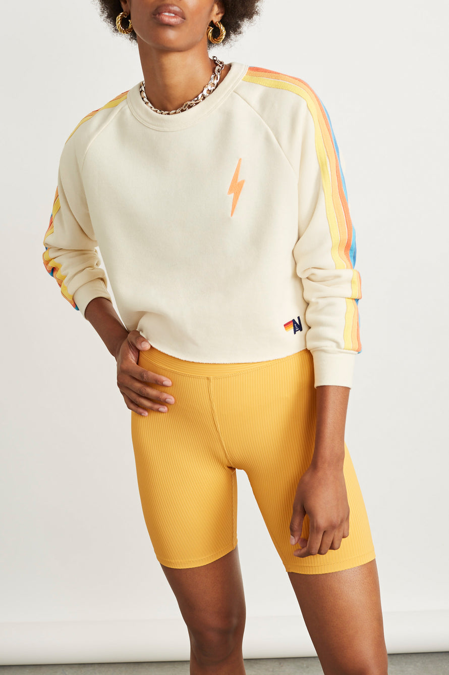 Bolt Cropped Classic Crew Sweatshirt by Aviator Nation in Vintage White/orange 1