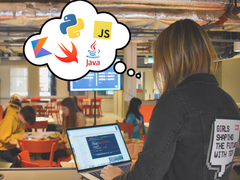 Woman coding and thinking about programming languages, including Kotlin, Python, Swift, JavaScript and Java