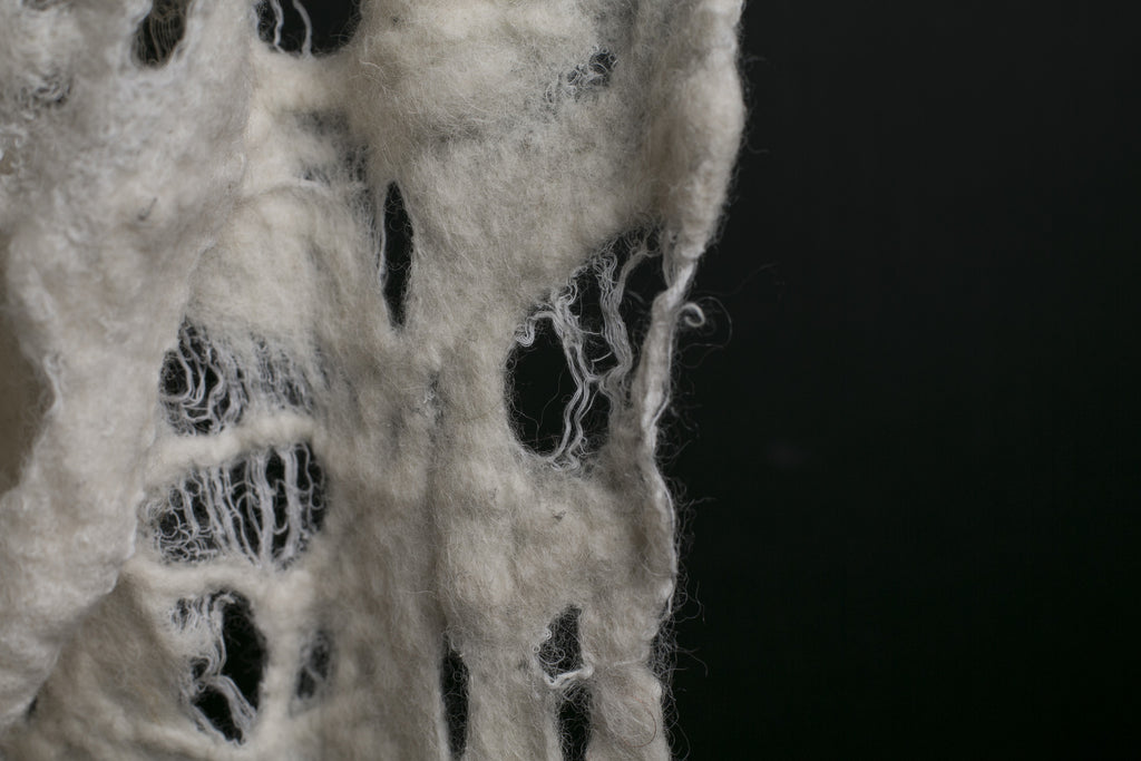 White hand felted distressed scarf
