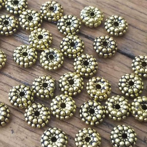 Ten Gold Tone Spacer Beads