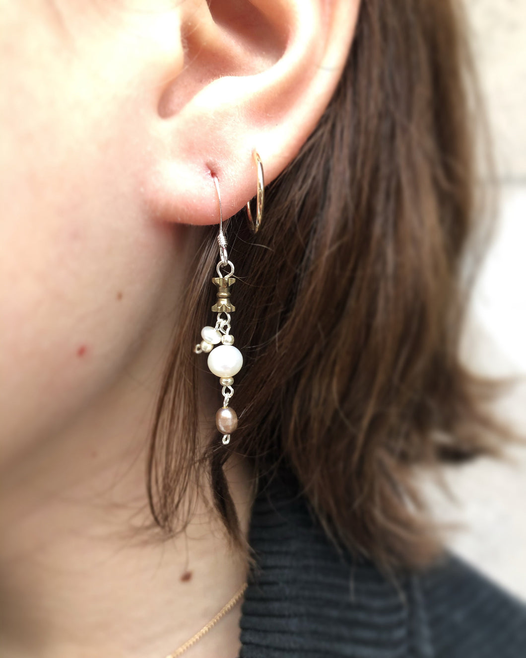 Pearl earrings with brass accents and sterling silver ear wires.