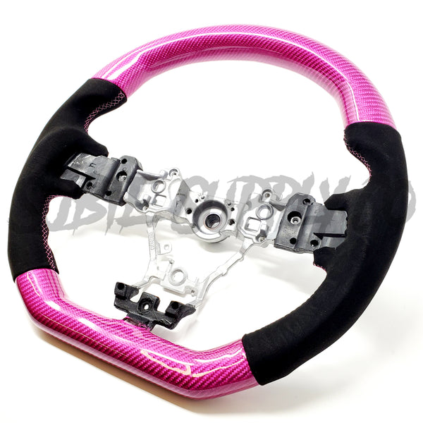 BLACK ALCANTARA/PINK CARBON FIBER STEERING WHEEL WITH PINK STITCHING  - 2015+ WRX/STI