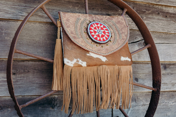 KitKu Leather and Hide clutch