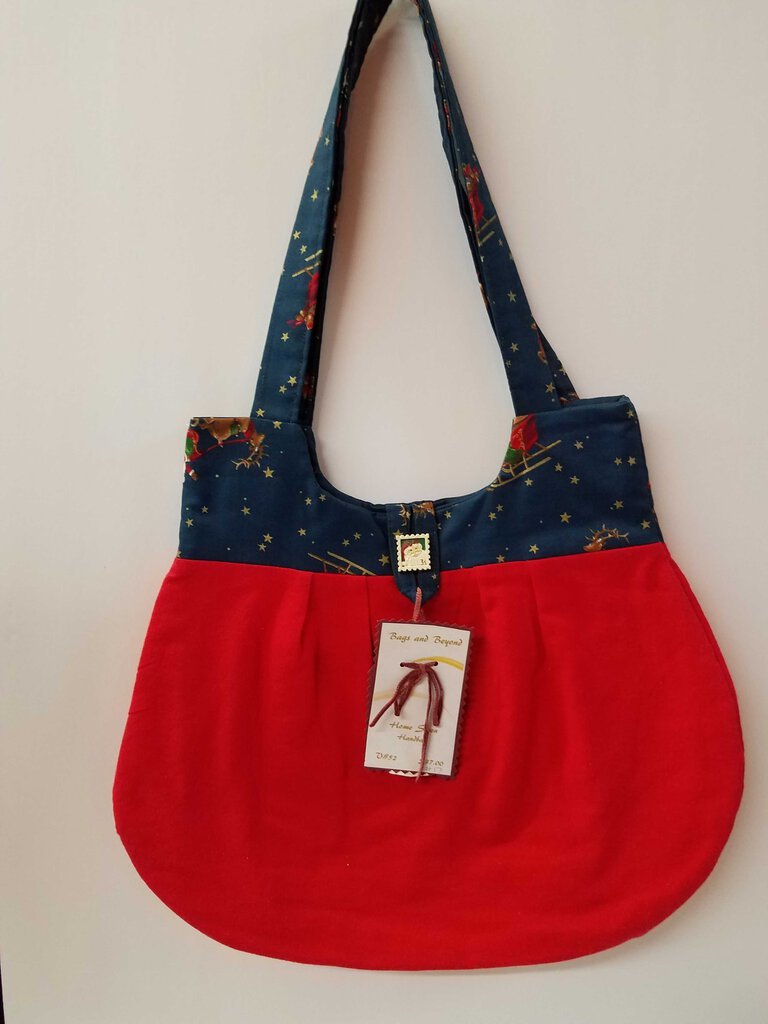 Santa's flight over Red Rounded Shoulder Bag