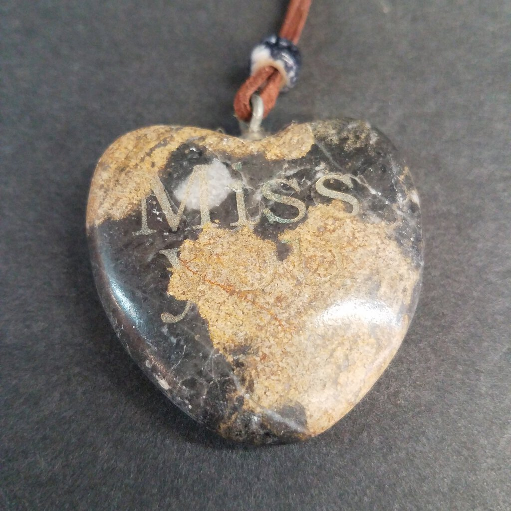 Suede Leather Necklace with Stone Heart with Etched into it.