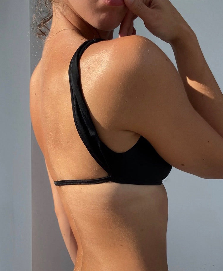 Black open back swim top wtih tie strings and thick strap deep neckline