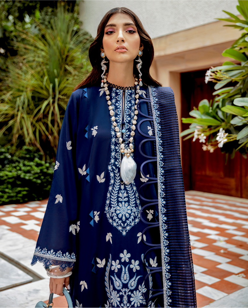 Buy Zaha Lawn Indian Pakistani Designer Suit 2020 - BARJABEEN Online at Great Price in See Blue with White. A pastel hued beauty, 'Barjabeen' features embroidered florals in bloom on a dreamy periwinkle canvas. Book ready to wear/standard sizes or customise it at LebaasOnline