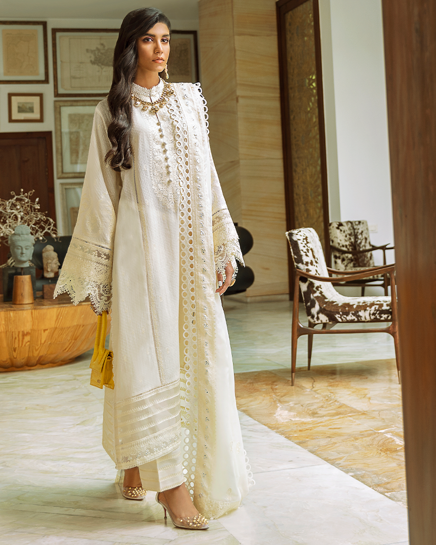 Buy Zaha Lawn Indian Pakistani Designer Suit 2020 - YALINA Online at Great Price in See Blue with White. A pastel hued beauty, 'Yalina' features embroidered florals in bloom on a dreamy periwinkle canvas. Book ready to wear/standard sizes or customise it at LebaasOnline