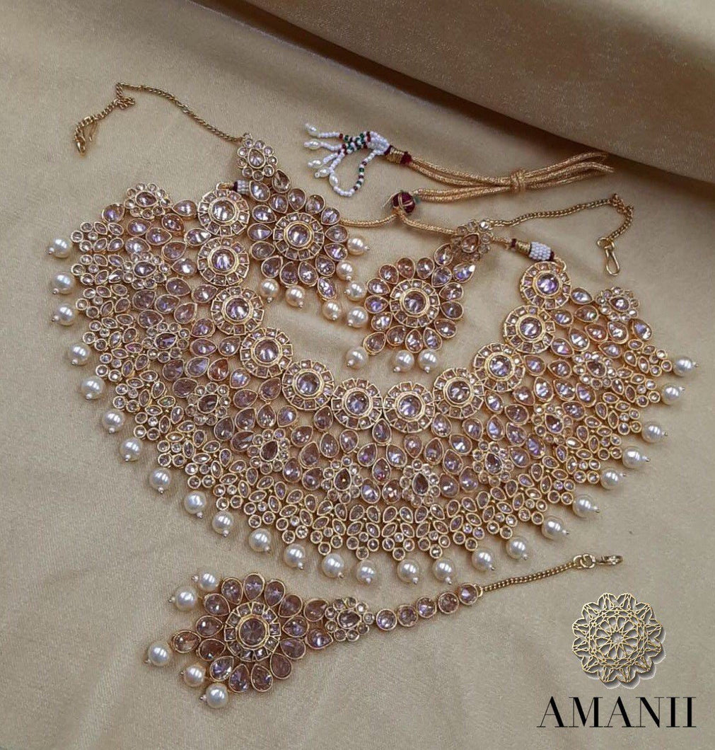 Indian wedding Jewellery sets in gold and crystals - LebaasOnline