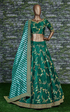 Load image into Gallery viewer, SABYASACHI inspired wedding lehnga in teal green - LebaasOnline