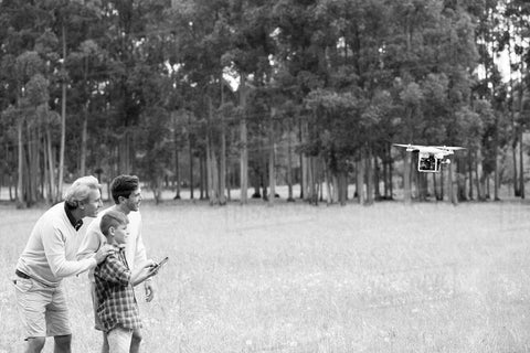 grandpa with drone with kid