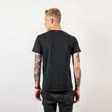 HOWL classic tee black worn by Sam Thompson back shot