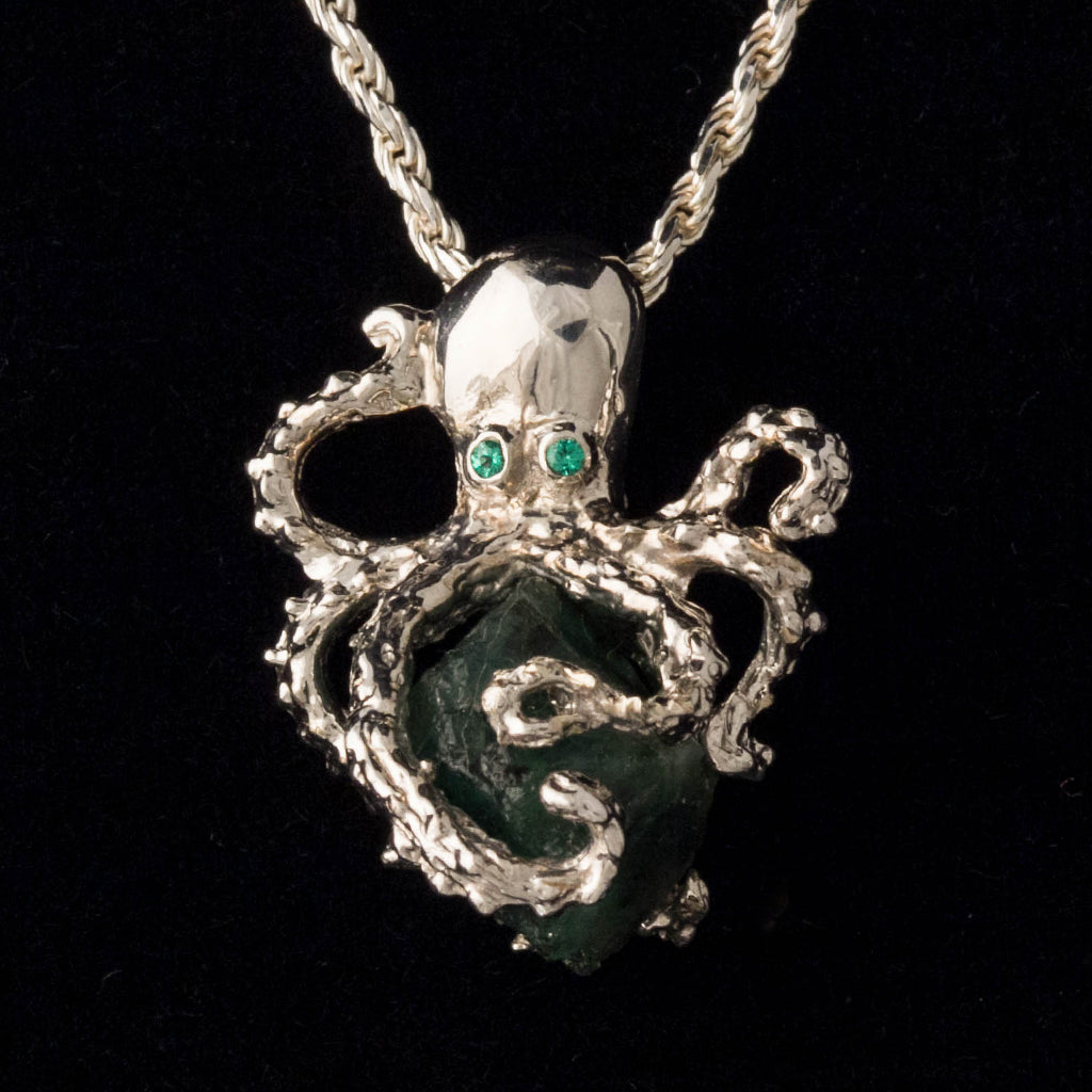 "Un-Cut Colombian Emerald, Mounted in Sterling Silver, Including an 20"" Sterling Silver Chain"