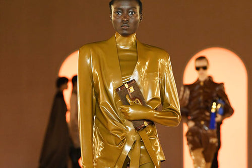 Female Model Wearing A Brown Balmain Latex Outfit At Runway Show