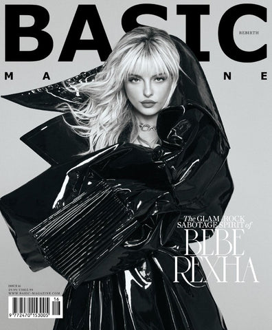 Bebe Rexha wearing oversized black latex outfit on the cover of Basic Magazine looking right into the camera