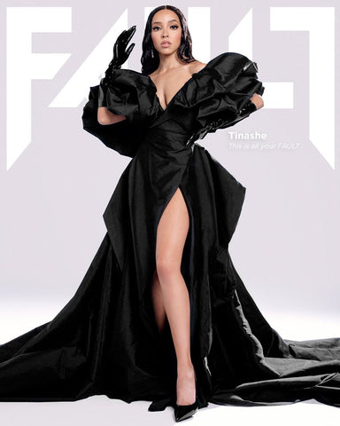 Tinashe wearing black Vex Gloves and flowing black dress with leg slit on the cover of FAULT Magazine