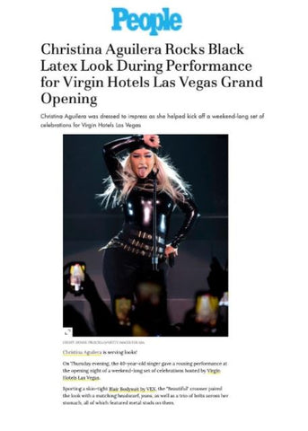 Christina Aguilera featured in People Magazine wearing black Vex latex bodysuit and bandana performing on stage