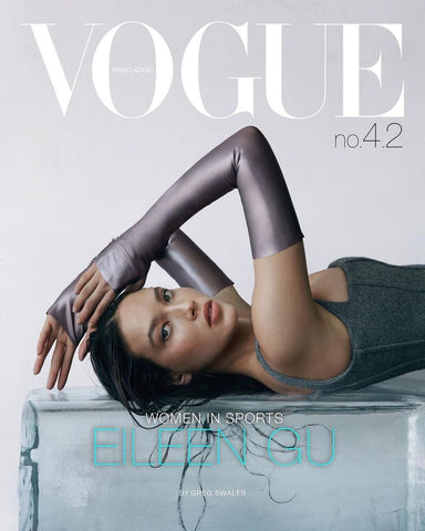 Model laying on a table facing the camera wearing Vex's Opera Knuckle Gloves for the cover of Vogue