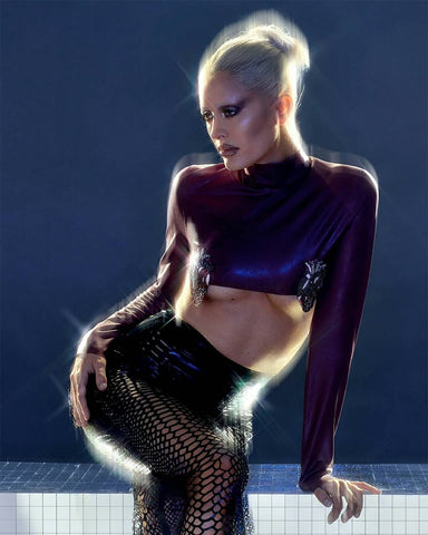 Woman wearing Vex's black python skirt and a long sleeved top featured in Odalisque Magazine.
