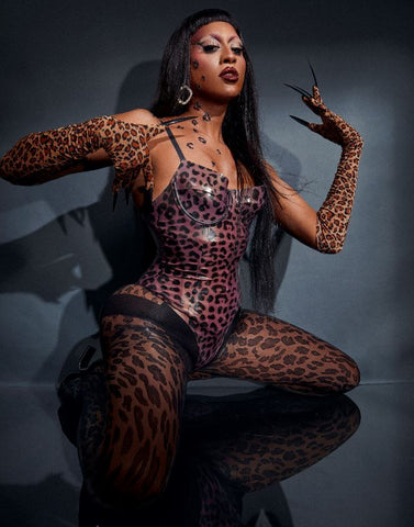 Priyanka dressed in Vex's leopard print bodysuit with matching gloves, tights and long black nails for a photoshoot