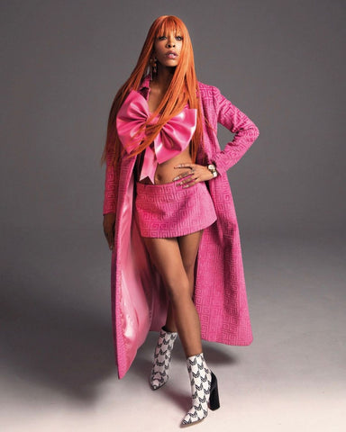 Rico Nasty wearing a Vex Custom pink bow Corset, pink mini skirt and pink trench coat for her spread in Wonderland Magazine's