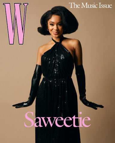 Recording artist Saweetie wearing a long black gown and Vex black latex opera gloves posing on the cover of W Magazine