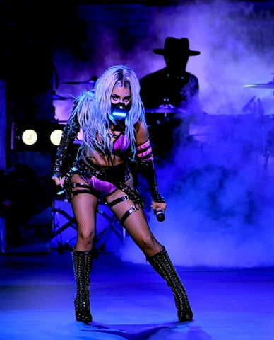 Lady Gaga performing on stage at the VMAs wearing Vex Custom Pyramid Latex Bolero with spikes and buckle Gauntlet