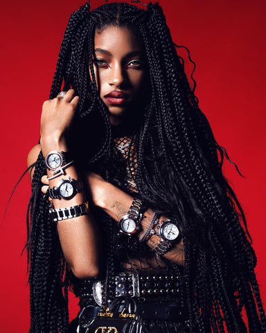 Willow Smith on the cover of V Magazine wearing Vex black fishnet crop top posing against a red background for a rocker look