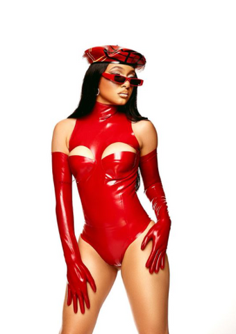 Woman wearing red Vex latex bodysuit, red latex opera gloves with a plaid beret and sunglasses