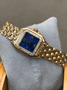 90's Cartier Panther Lapis Dial Gold and Diamonds.