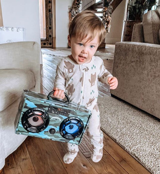Brittany's little one with its favorite Boom Box