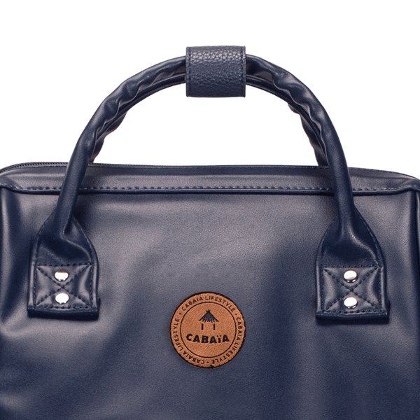 Load image into Gallery viewer, Details of the logo of the navy backpack Cabaïa Milan