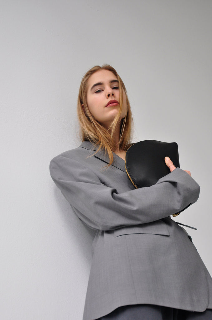 Female model with leather bag