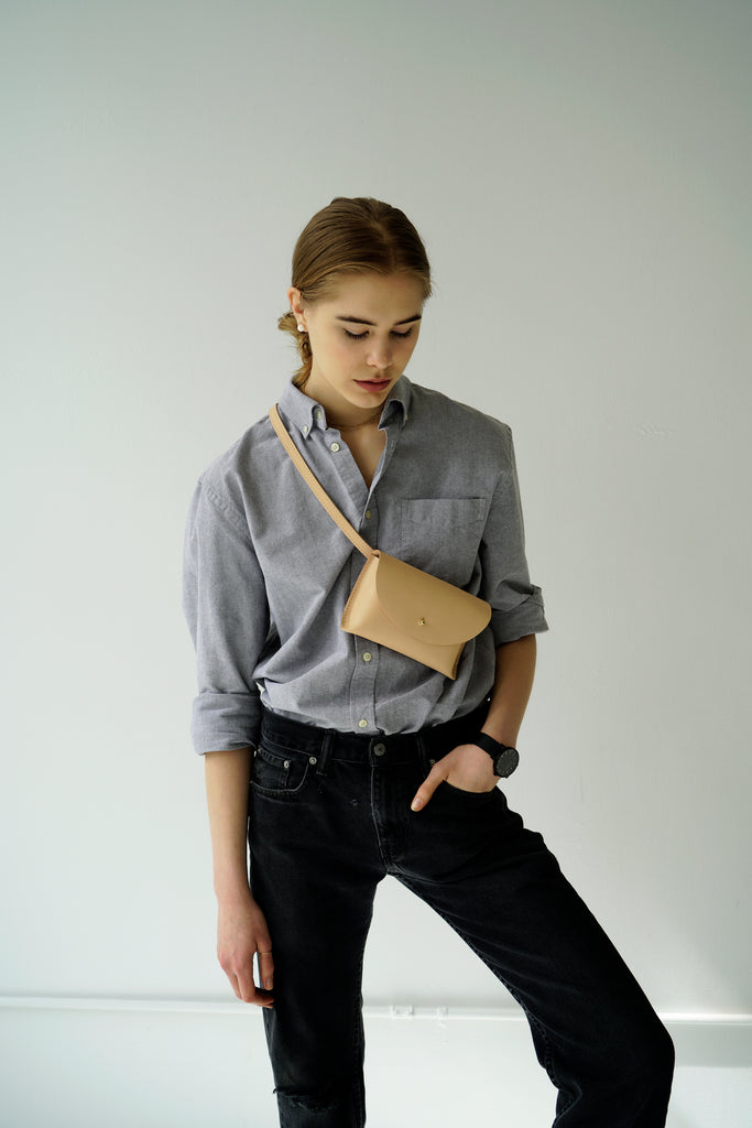 Female model with leather fanny pack