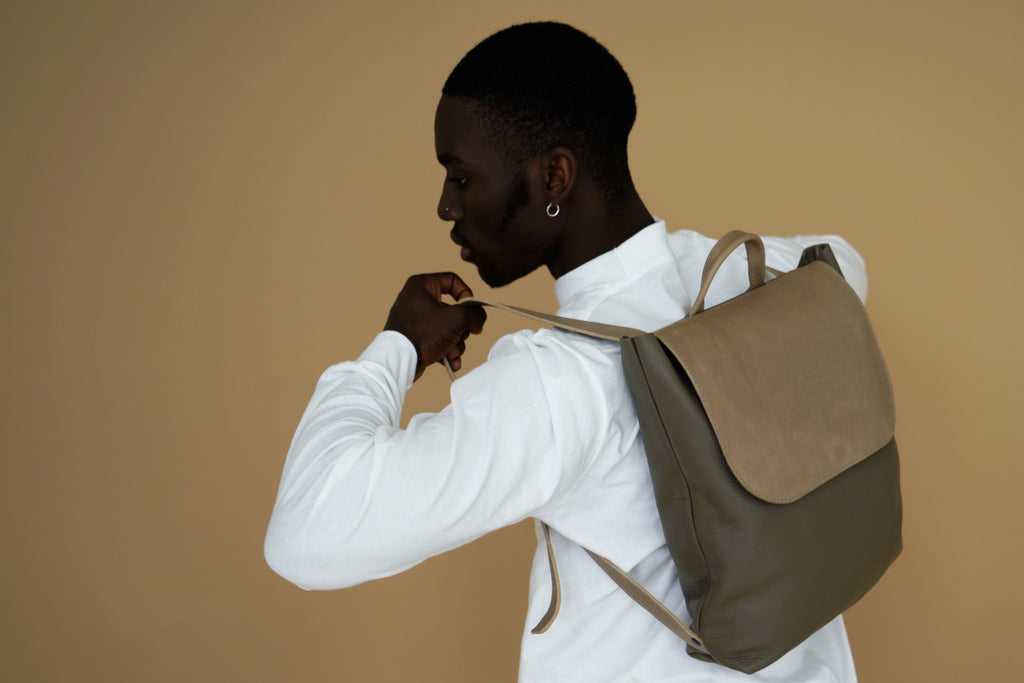 male model with leather backpack