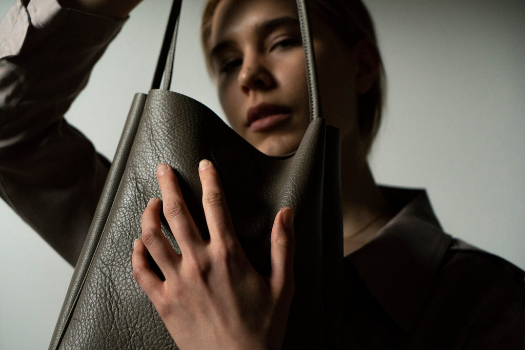 female model with leather tote bag