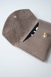 front view of the glare card holder in taupe leather