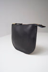 front view of the dawn pouch in black Horween essex veg tan leather