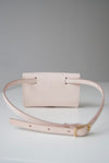 Front view of the Glare Sling in beige veg tan leather