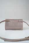 front view of the glare sling in taupe leather