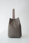 front view of the large aura backpack in taupe pebbled leather