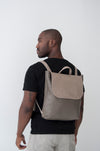 front view of the large ray backpack in taupe pebbled leather with veg tan flap